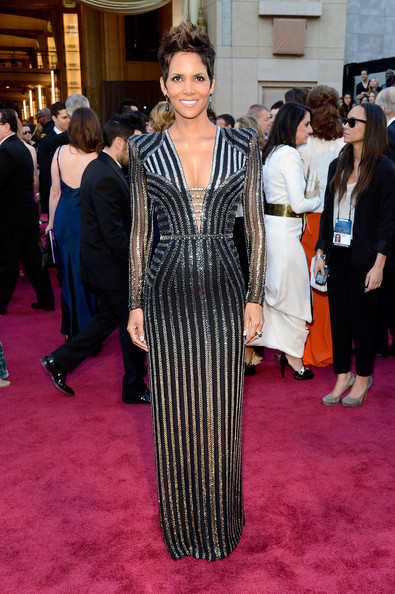 Halle Berry wearing a black and  silver striped dress custom-made by Donatella Versace especially for her. This is just beyond! Halle needs to get rid of that do but she's just beautiful right?