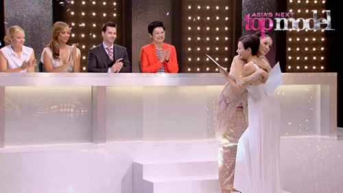 Jessica getting a hug from host Nadya after being declared the first winner of Asia's Next Top Model!