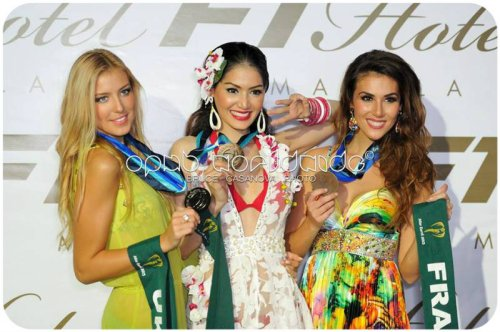 Miss Earth 2013 Resort Wear winners from (L-R) Ukraine (Silver), Thailand (Gold), France (Bronze)