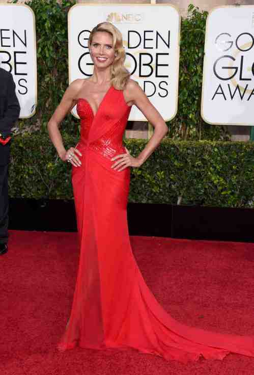 Heidi Klum looking glorious in a red Versace number. Cmon' doesn't she age at all? Just WOW.