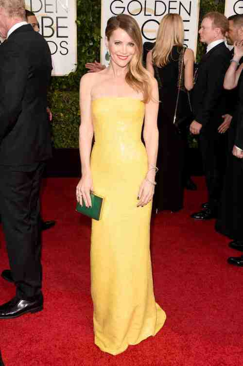In a scene-stealing yellow KaufmanFranco strapless gown, Leslie Mann clearly knows how to get attention - for the right reason!