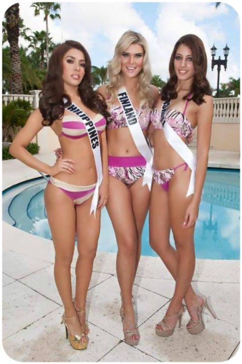 Miss Philippines MJ Lastimosa with Bea Toivonen of Finland and Doron Matalon of Israel.
