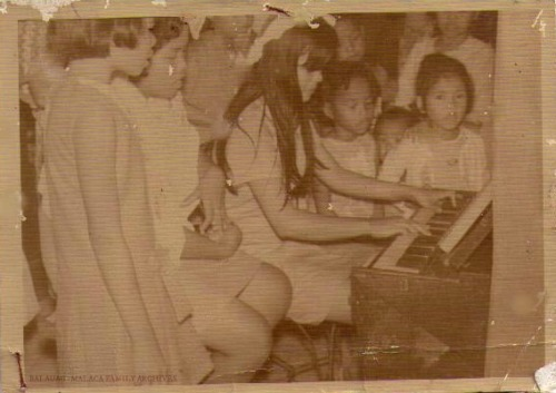 My Mom as a young lady playing at a church in Pampanga.