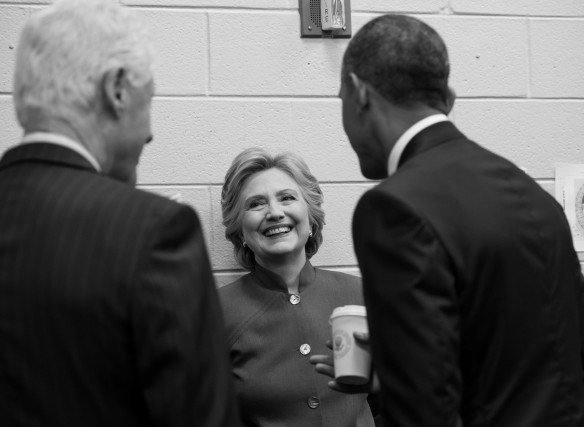 Hillary Clinton, all smiles while chatting with Bill and President Barack Obama during the Democratic National Convention this year [photo by Barbara Kinney]